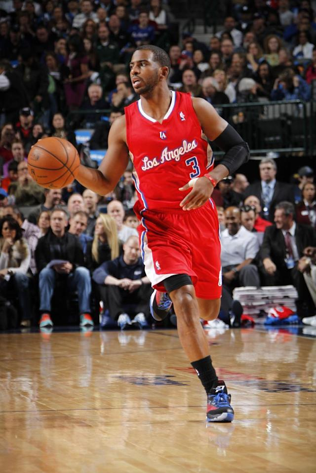 DALLAS, TX - JANUARY 3: Chris Paul #3 of the Los Angeles Clippers dribbles the ball against the Dallas Mavericks on January 3, 2014 at the American Airlines Center in Dallas, Texas. (Photo by Glenn James/NBAE via Getty Images)