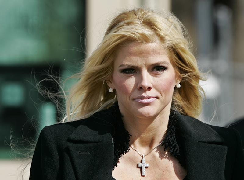 FILE - This Feb. 28, 2006 file photo shows actress-model Anna Nicole Smith leaving the U.S. Supreme Court in Washington. An appellate court said a trial judge erred in dismissing conspiracy convictions against Smith's psychiatrist and manager, a ruling that defense attorneys said could send the case in different directions. The ruling came after Superior Court Judge Robert Perry chose to throw out the 2010 jury verdict that manager Howard K. Stern and psychiatrist Khristine Eroshevich conspired to obtain prescription drugs for the troubled model by using false names. Smith died in Florida on Feb. 8, 2007, of an accidental drug overdose.  (AP Photo/Manuel Balce Ceneta, file)