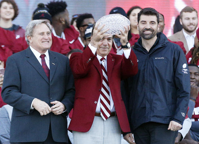 Alabama coach Nick Saban holds up the 'coaches trophy' during the NCAA college football national championship celebration, Saturday, Jan. 20, 2018, in Tuscaloosa, Ala. Alabama won the national championship game against Georgia 26-23 in overtime. (AP Photo/Brynn Anderson)