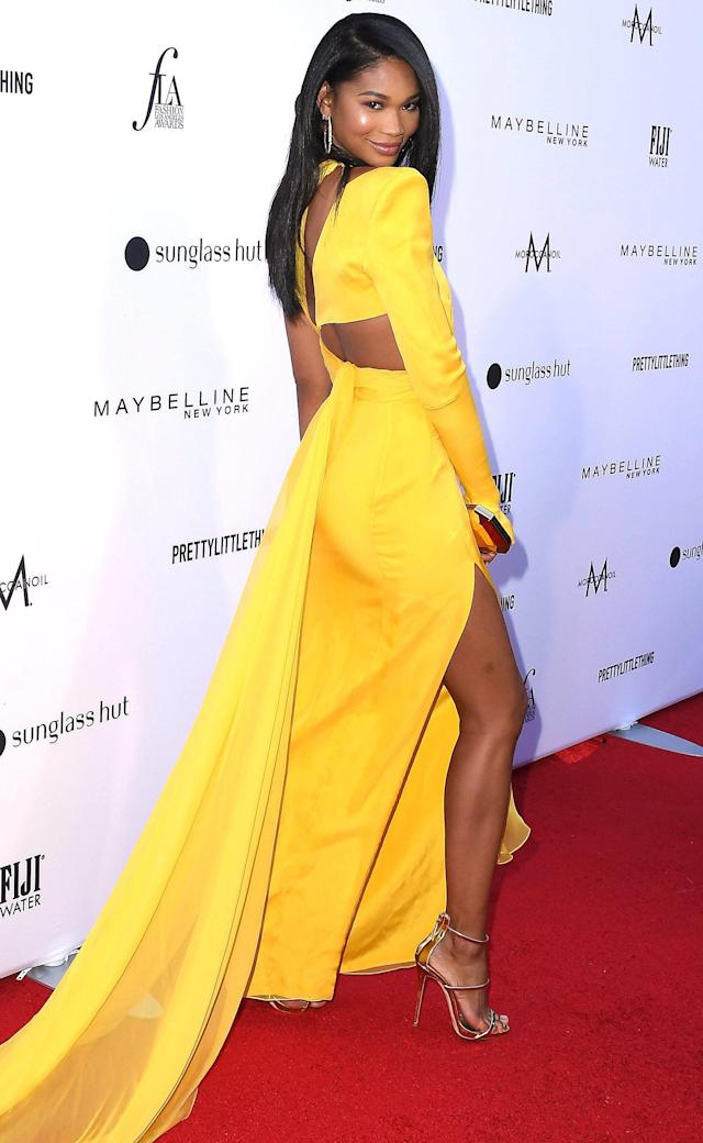 996b263bc3 in a one shoulder cutout Julien Macdonald bright yellow gown with a side  thigh high slit
