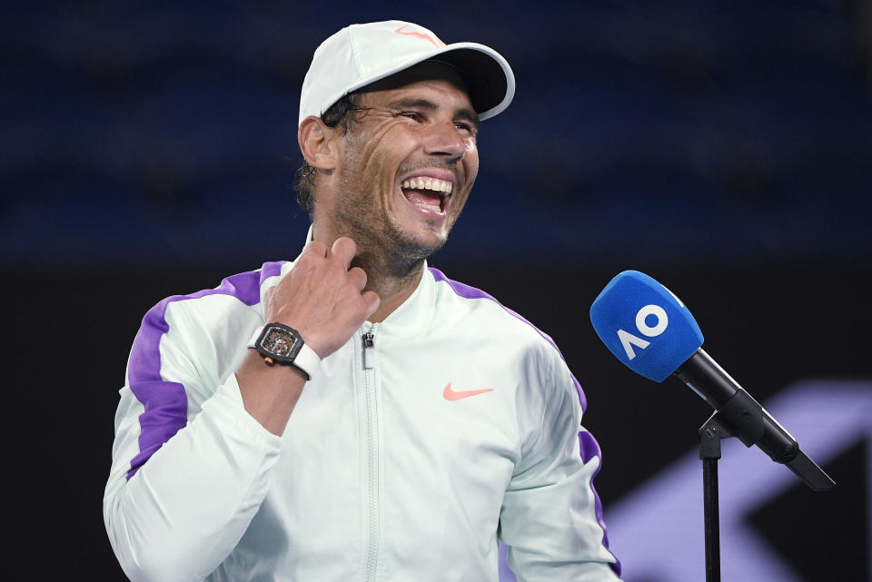 Spain's Rafael Nadal laughs during an interview following his win over Britain's Cameron Norrie in their third round match a the Australian Open tennis championships in Melbourne, Australia, Saturday, Feb. 13, 2021. (AP Photo/Andy Brownbill)