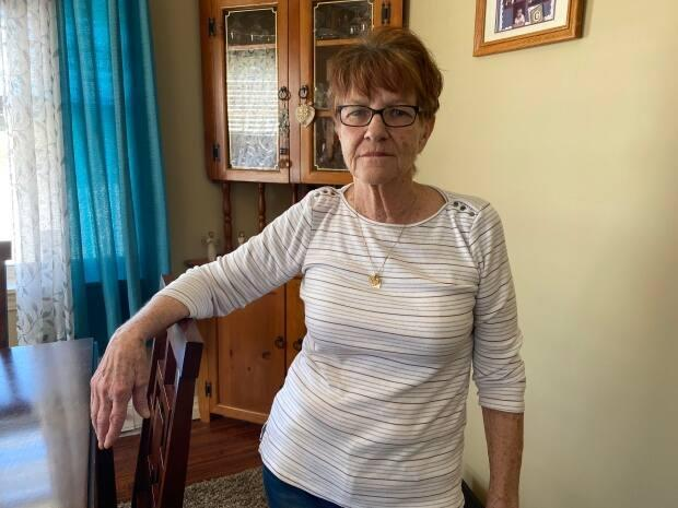 Wanda Gaudet says she has lived in the home, tucked in a quiet, tree-lined street in Miscouche for seven years. (Kirk Pennell/CBC - image credit)