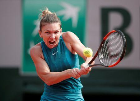 FILE PHOTO: Tennis - French Open - Roland Garros, Paris, France - June 9, 2018 Romania's Simona Halep in action during the final against Sloane Stephens of the U.S. REUTERS/Benoit Tessier/File Photo