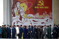 Delegates arrive at the national convention center to attend the 13th Communist Party Congress in Hanoi, Vietnam Tuesday, Jan. 26, 2021. Vietnam's ruling Communist Party has begun a crucial weeklong meeting in the capital Hanoi to set the nation's path for the next five years and appoint the country's top leaders. (AP Photo/Minh Hoang)