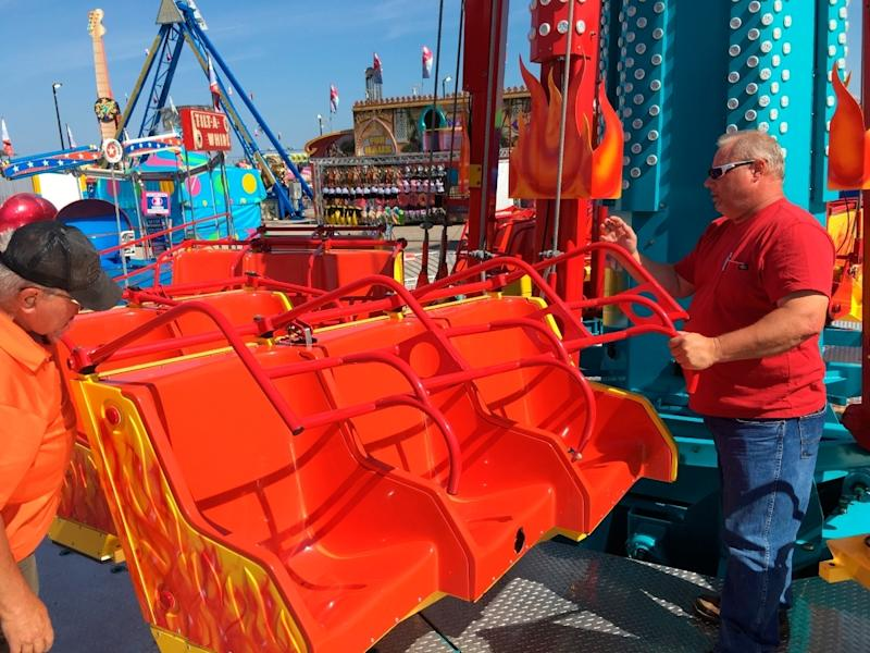 Safety inspectors Bill Szerletich, left, and Brian Brown inspect carnival rides at the Illinois State Fair in Springfield, Illinois, Aug. 9, 2018.