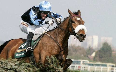 Silver Birch ridden by Robbie Power jumps the last fence on the way to winning the 2007 Grand National Steeple chase - Credit: Reuters
