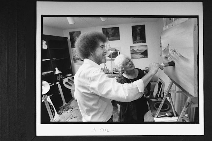 """<div class=""""inline-image__caption""""><p>Bob Ross at easel painting one of his mountain landscapes as his business partner Annette Kowalski looks on in his studio at home.</p></div> <div class=""""inline-image__credit"""">Acey Harper/Getty</div>"""
