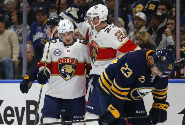 Florida Panthers Denis Malgin (62) and Troy Brouwer (22) celebrates a goal during the second period of an NHL hockey game against the Buffalo Sabres, Tuesday, Dec. 18, 2018, in Buffalo N.Y. (AP Photo/Jeffrey T. Barnes)