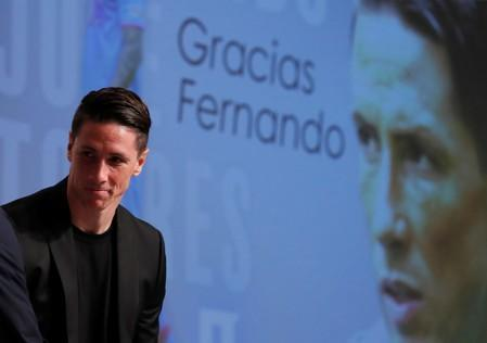 Tributes pour in as Spanish striker Torres retires
