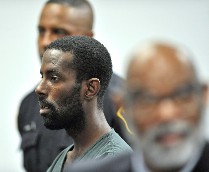 FILE - In this June 20, 2019 file photo, Deangelo Martin stands for a probable cause hearing, in Detroit. Murder charges could be announced against Martin suspected of killing at least four women and stowing their bodies in vacant houses in Detroit. Wayne County Prosecutor Kym Worthy is expected Wednesday, Sept. 18, to discuss the case against 34-year-old Martin. (Todd McInturf/Detroit News via AP, File)