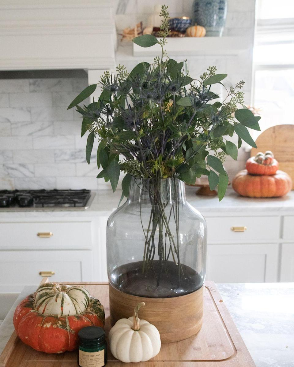 """<p>When in doubt, layer pumpkins. An assortment of pumpkins in a range of hues is a failsafe way to transition your home for the fall season. Place them on your kitchen island, bookshelf, or a coffee table for a fun look, as Fujikawa of <a href=""""https://thehabitatstudio.com/"""" rel=""""nofollow noopener"""" target=""""_blank"""" data-ylk=""""slk:Habitat Studio"""" class=""""link rapid-noclick-resp"""">Habitat Studio</a> has done here. """"We also love to dip into our local nursery for our festive pumpkins and gourds,"""" Fujikawa says. """"Try sage-colored pumpkins, white Cinderella pumpkins, or tiger stripe pumpkins."""" She also suggests stacking them on top of each other for added visual interest. </p>"""