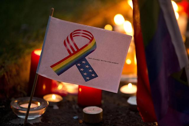 <p>A tribute message and design stands amongst candles laid at Saint Anne's Church in the Soho district of central London, during a vigil for the victims of Sunday's Orlando shootings at a gay nightclub in Florida, Monday June 13, 2016. (AP Photo/Matt Dunham) </p>