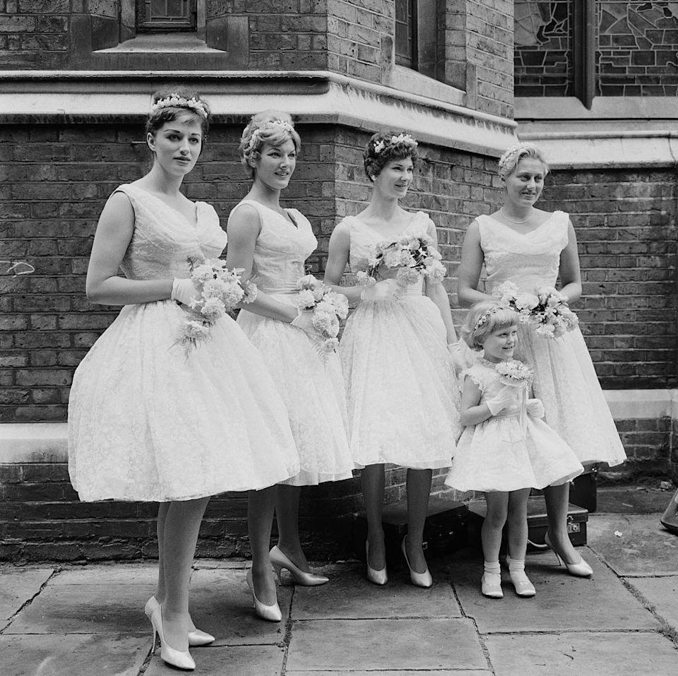 <p>Tulle, tulle, and more tulle was the look of the mid- to late '50s. While hems on bridesmaids dresses became shorter during this time, but that didn't mean they lost their wide brimmed look. </p>