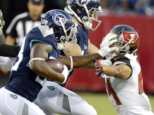Tennessee Titans running back Dion Lewis, left, pushes Tampa Bay Buccaneers defensive back Brent Grimes (24) away in the first half of a preseason NFL football game Saturday, Aug. 18, 2018, in Nashville, Tenn. (AP Photo/Mark Zaleski)
