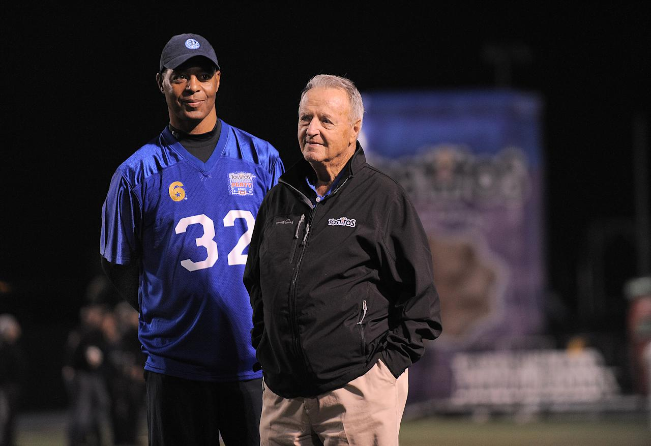 "IMAGE DISTRIBUTED FOR TOSTITOS: From left, Former NFL player Marcus Allen and coach Bobby Bowden joined the ""Tostitos Homecoming Party Bowl"" hosted at Cerritos College on Thursday, December 13, 2012 in Norwalk, Calif. The Tostitos brand surprised 28 unsuspecting veterans with the ultimate football party and star-studded event that included football greats, Bobby Bowden, Marcus Allen and actor/screenwriter, Owen Wilson. (Photo by Jordan Strauss/Invision for Tostitos/ AP Images))"