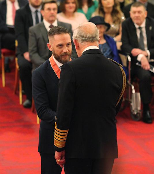 <p>The actor, who declined to talk to the waiting press, was presented with his CBE insignia by the Prince of Wales.</p>
