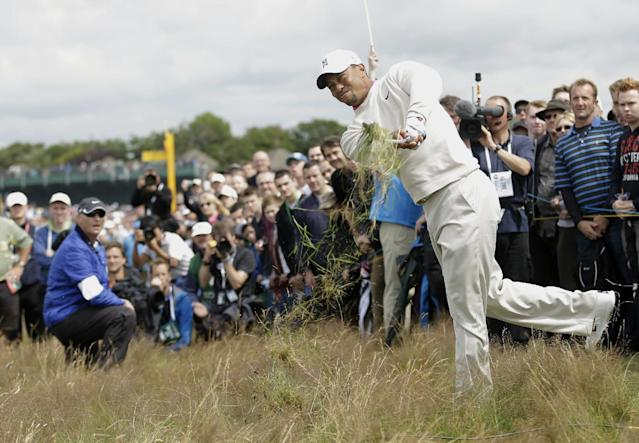 Tiger Woods of the United States plays out of the rough on the 15th hole at Royal Lytham & St Annes golf club during the first round of the British Open Golf Championship, Lytham St Annes, England, Thursday, July 19, 2012. (AP Photo/Peter Morrison)