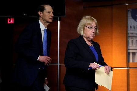 U.S. Senators Patty Murray (D-WA) and Ron Wyden (D-OR) arrive at a news conference on U.S. President Donald Trump's administration's first 100 days and healthcare, on Capitol Hill in Washington, U.S., April 26, 2017. REUTERS/Yuri Gripas