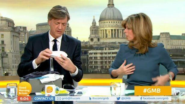 Richard Madeley demonstrates a piece of male breastfeeding equipment