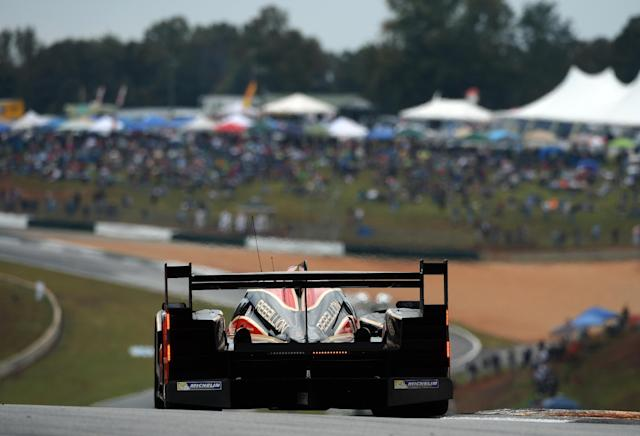 Neel Jani, of Switzerland, drives the Rebellion Racing Lola B12/60 Toyota during the American Le Mans Series' Petit Le Mans auto race at Road Atlanta, Saturday, Oct. 19, 2013, in Braselton, Ga. (AP Photo/Rainier Ehrhardt)
