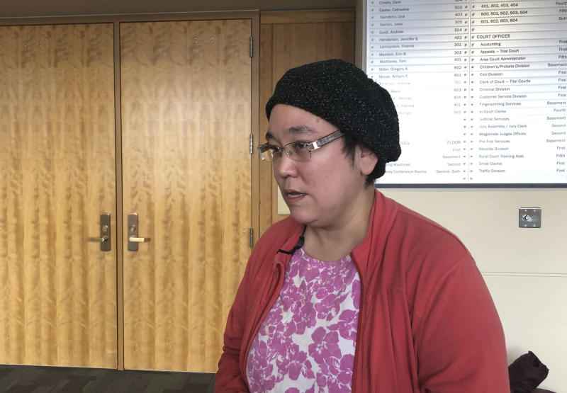 Tatauq Ruma speaks to reporters outside a courtroom in Anchorage, Alaska, Monday, Oct. 21, 2019. Ruma attended the arraignment of Brian Steven Smith, who is accused of killing Ruma's aunt, Veronica Abouchuk. He pleaded not guilty. (AP Photo/Mark Thiessen)
