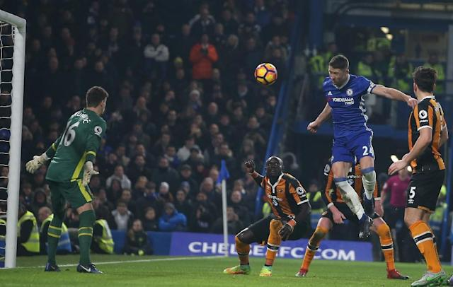 Chelsea's Gary Cahill jumps to head teh ball past Hull City's goalkeeper Eldin Jakupovic during the match at Stamford Bridge in London on January 22, 2017 (AFP Photo/Daniel LEAL-OLIVAS)