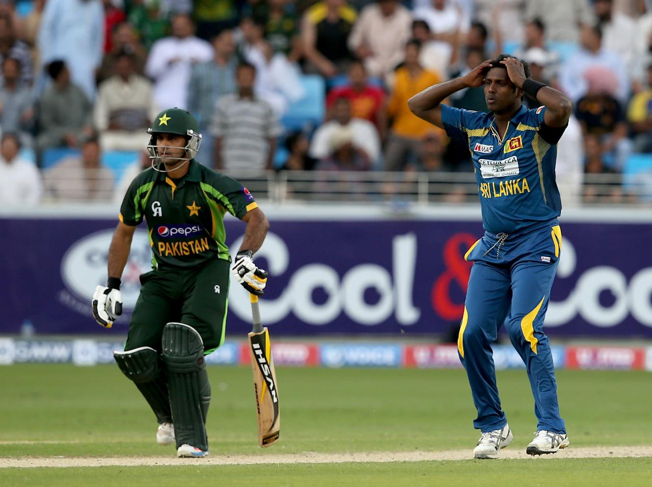 DUBAI, UNITED ARAB EMIRATES - DECEMBER 20:  Angelo Mathews reacts during the second One-Day International (ODI ) match between Sri Lanka and Pakistan at the Dubai Sports City Cricket Stadium on December 20, 2013 in Dubai, United Arab Emirates.  (Photo by Francois Nel/Getty Images)