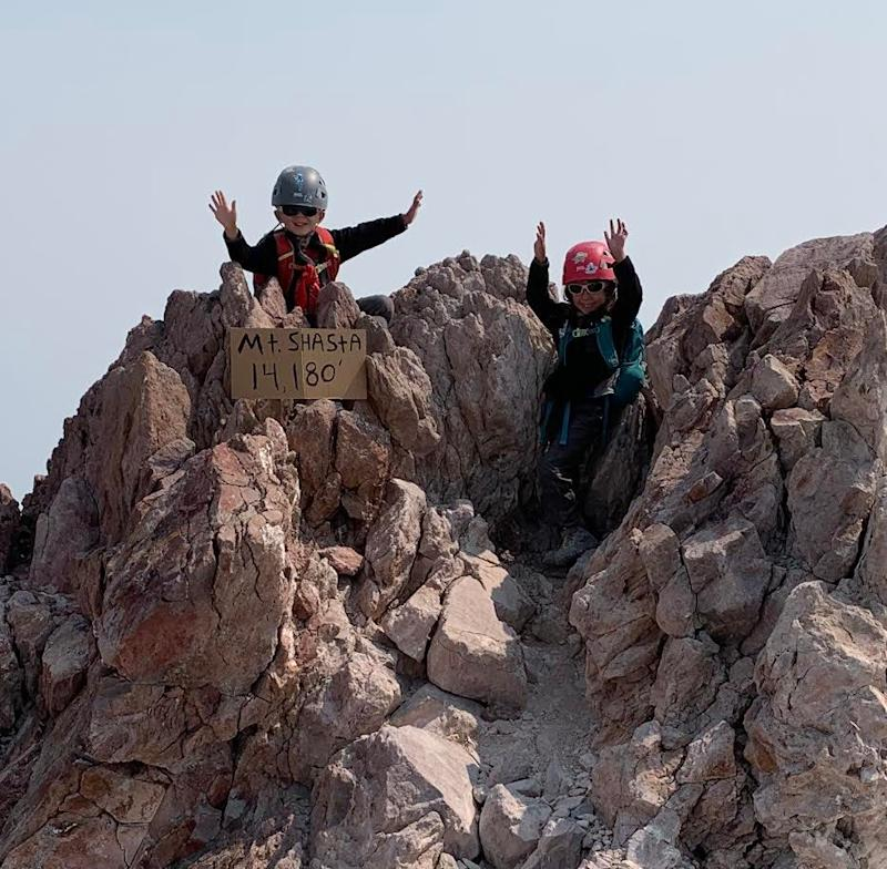 Matthew and Arabella Adams are shown celebrating their accomplishment at the peak of Mt. Shasta on Sept. 6, 2020. They are thought to be the youngest to ever summit the mountain.