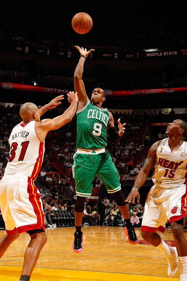 MIAMI, FL - OCTOBER 30: Rajon Rondo #9 of the Boston Celtics shoots against (L-R) Shane Battier #31 and Mario Chalmers #15 of the Miami Heat during the NBA game on October 30, 2012 at American Airlines Arena in Miami, Florida. NOTE TO USER: User expressly acknowledges and agrees that, by downloading and/or using this photograph, user is consenting to the terms and conditions of the Getty Images License Agreement. Mandatory copyright notice: Copyright NBAE 2012 (Photo by Issac Baldizon/NBAE via Getty Images)