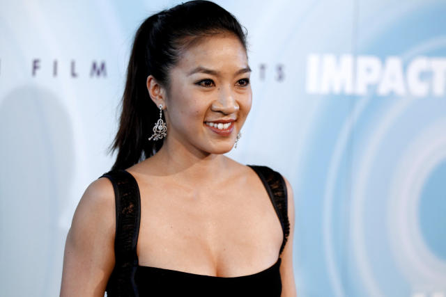 <p>Michelle Kwan arrives at the Crystal Lucy Awards on Thursday June 16, 2011 in Beverly Hills, Calif. (AP Photo/Matt Sayles) </p>
