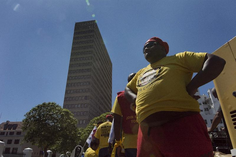 """Msember of South Africa's United Front rally outside parliament against what they call a """"pro-rich"""" Budget speech, on February 25, 2015, in Cape Town (AFP Photo/Rodger Bosch)"""