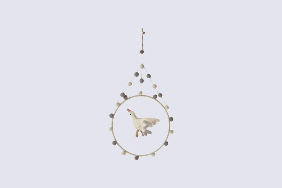 """<p>With its modern design and neutral palette, this whimsical mobile is an alluring addition to any nursery. It will encourage Baby to develop their hand eye coordination by inviting them to reach and grasp for engaging objects within their view.</p> <p><strong><em>Shop Now:</em></strong><em> Pehr """"Surprise Stork"""" Mini Hoop Mobile, $25, <a href=""""https://shoppehr.com/collections/hoop-mobiles/products/mini-hoop-mobile?variant=29851543535704"""" rel=""""nofollow noopener"""" target=""""_blank"""" data-ylk=""""slk:shoppehr.com"""" class=""""link rapid-noclick-resp"""">shoppehr.com</a></em><em>. </em></p>"""