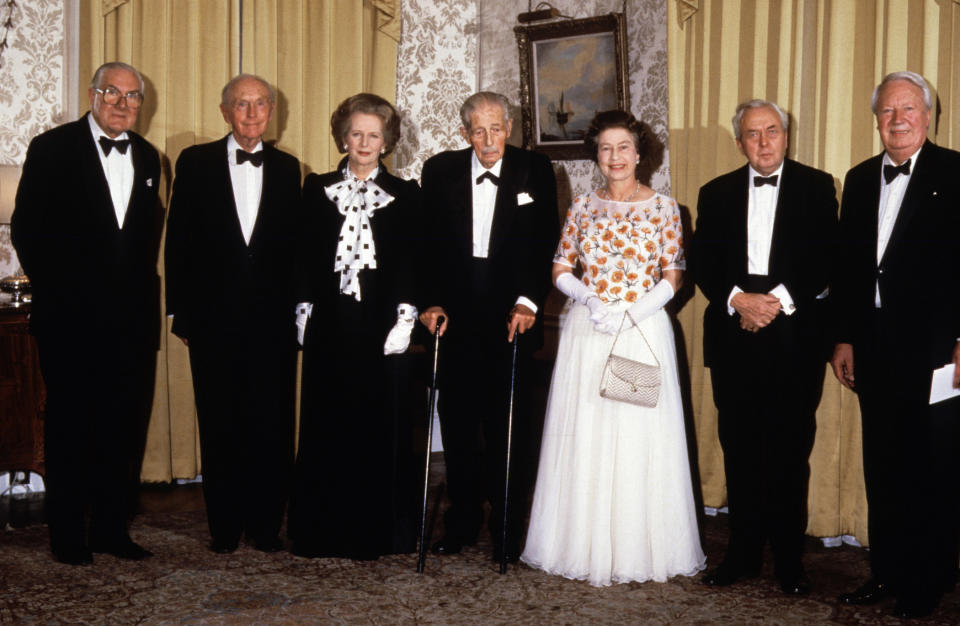 Prime Minister Margaret Thatcher is joined by Queen Elizabeth II and five former PMs at 10 Downing Street, London, as she hosts a dinner celebrating the 250th anniversary of the residence becoming the London home of Prime Ministers. From left: James Callaghan, Lord Home, Margaret Thatcher, Lord Stockton, The Queen, Lord Wilson and Edward Heath.