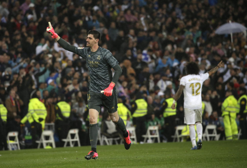 Real Madrid's goalkeeper Thibaut Courtois celebrates during the Spanish La Liga soccer match between Real Madrid and Barcelona at the Santiago Bernabeu stadium in Madrid, Spain, Sunday, March 1, 2020. (AP Photo/Andrea Comas)