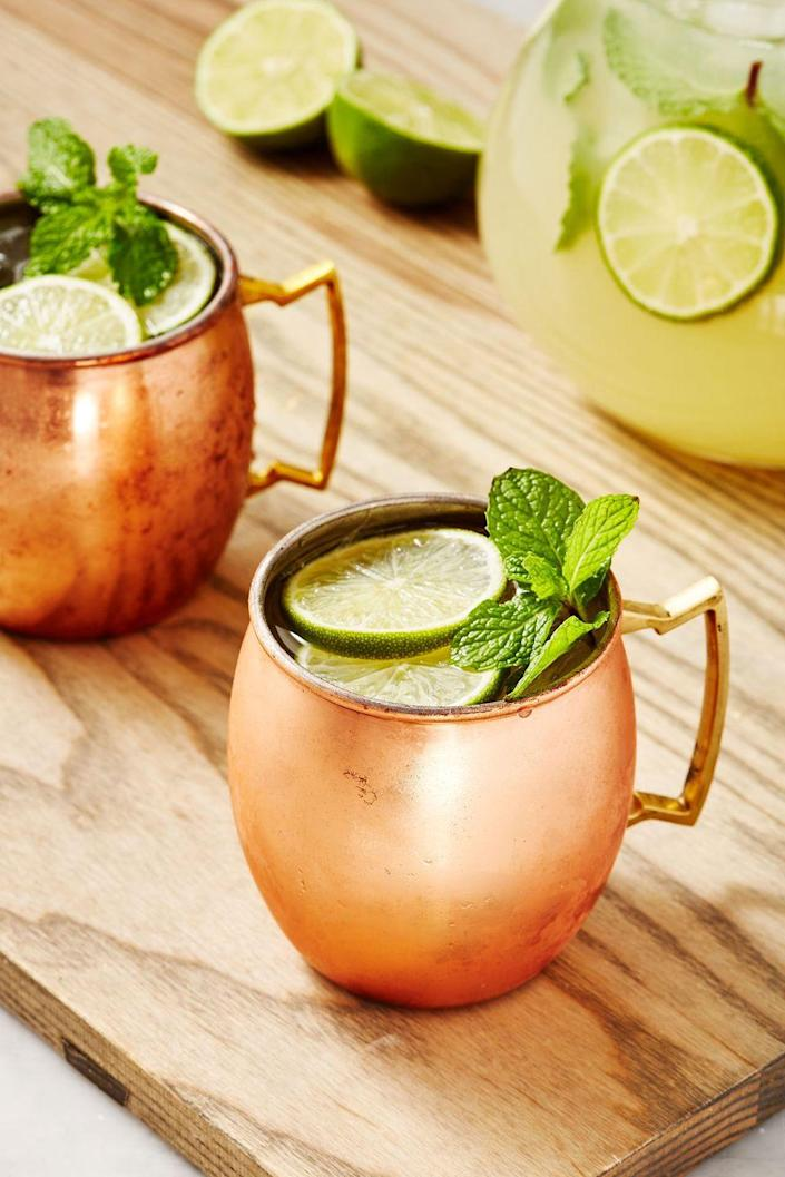 "<p>Basically an enormous mule. Don't forget the copper mugs!</p><p>Get the recipe from <a href=""https://www.delish.com/cooking/recipe-ideas/a22698590/moscow-mule-punch-recipe/"" rel=""nofollow noopener"" target=""_blank"" data-ylk=""slk:Delish"" class=""link rapid-noclick-resp"">Delish</a>.</p>"