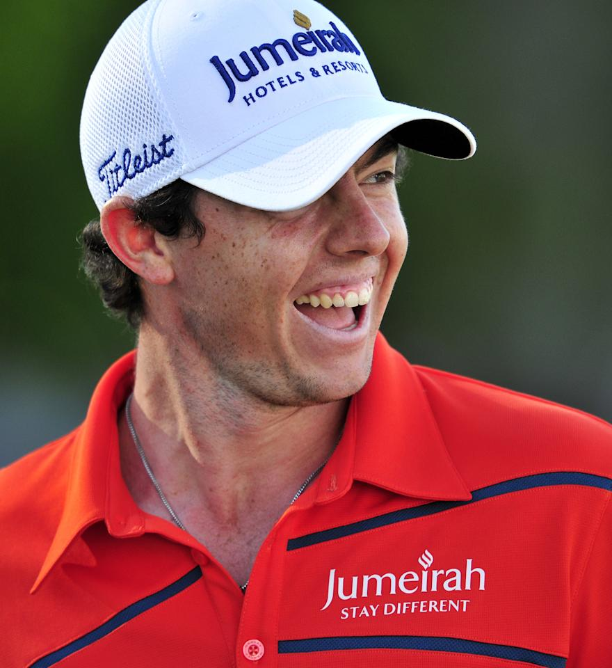 Northern Irish golfer Rory McIlroy smiles after finishing the second round of the BMW PGA Championship at Wentworth Golf Club in Surrey, on May 25, 2012. AFP PHOTO/GLYN KIRKGLYN KIRK/AFP/GettyImages