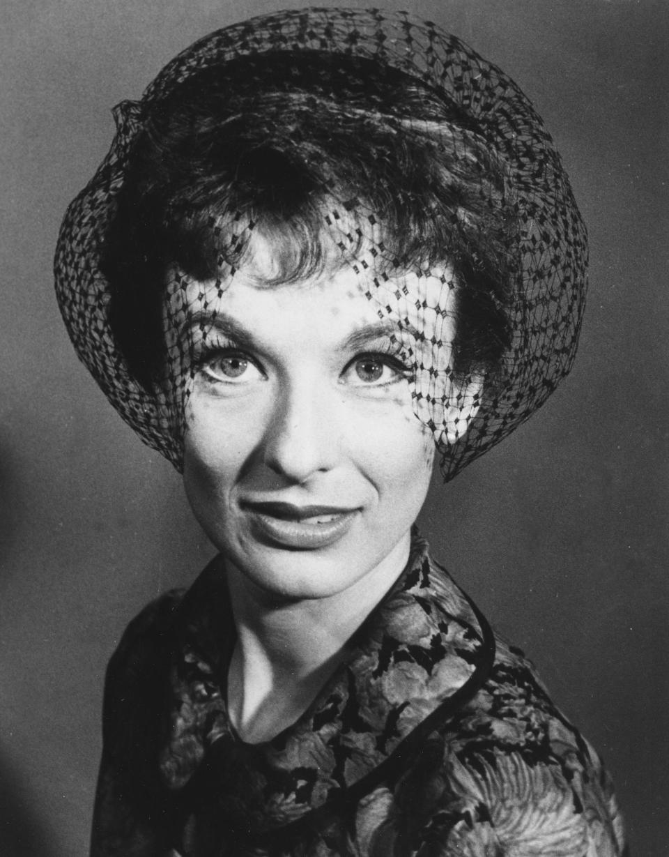 "FILE - Actress Cloris Leachman wears a headband hat with black tulip shaped veiling, called a topette by designer Alfred Brod, in May 1959. Leachman, a character actor whose depth of talent brought her an Oscar for the ""The Last Picture Show"" and Emmys for her comedic work in ""The Mary Tyler Moore Show"" and other TV series, has died. She was 94. (AP Photo, File)"