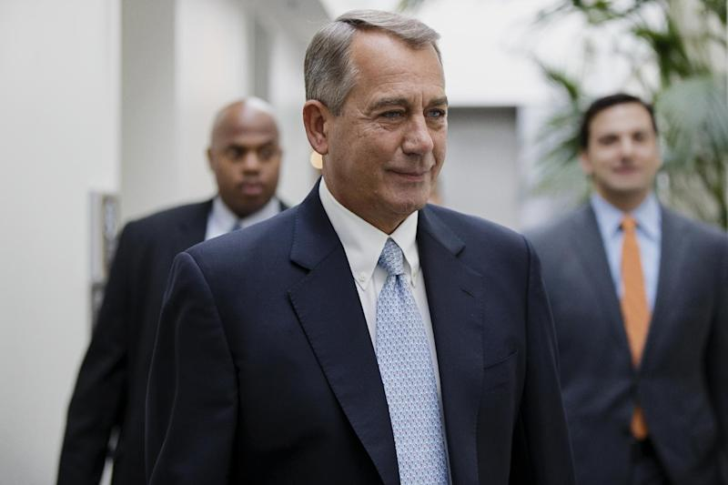 House Speaker John Boehner of Ohio smiles as walks to a strategy meeting with fellow Republicans before speaking to reporters about the Keystone XL Pipeline and other issues, Tuesday, Feb. 4, 2014, on Capitol Hill in Washington. (AP Photo/J. Scott Applewhite)