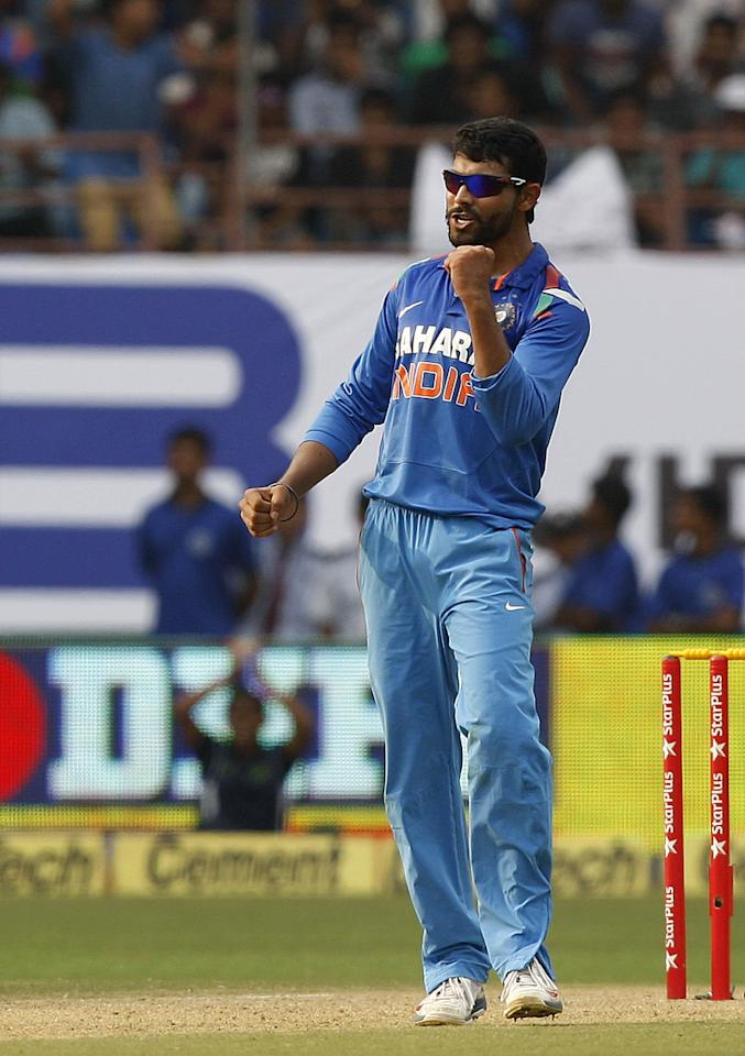 Indian cricketer Ravindra Jadeja celebrates fall of a wicket during the 1st ODI match between India and West Indies at Nehru Stadium in Kochi on Nov.21, 2013. (Photo: IANS)