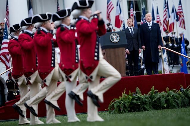 <p>France's President Emmanuel Macron (2R) and US President Donald Trump (R) watch troops during a state arrival ceremony on the South Lawn of the White House, April 24, 2018 in Washington. (Photo: Brendan Smialowski/AFP/Getty Images) </p>