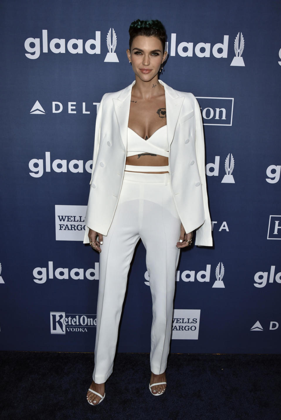 """<p>Is this Ruby Rose's official induction into Taylor Swift's squad? The singer surprised the audience at the event to present an award to Rose, who wore a white Aquilano Rimondi suit with a crop top and Stuart Weitzman sandals. """"Of all the possible things that could trigger me and make me cry, I didn't think about Taylor Swift coming to give me the award,"""" she said during her acceptance speech. The DJ and actress added a pop of color with a green braid on the top of her head. <i>(Photo: AP)</i></p>"""