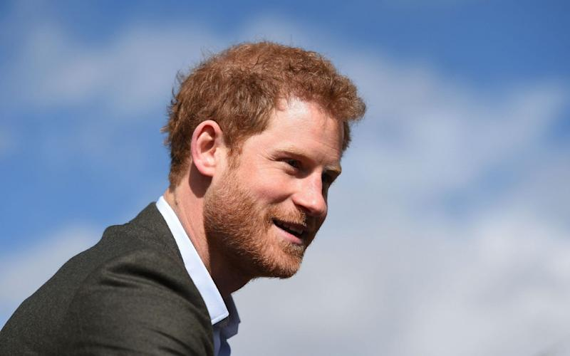 Prince Harry was  praised for his bravery after revealing he had sought counselling to help come to terms with the death of his mother - AFP