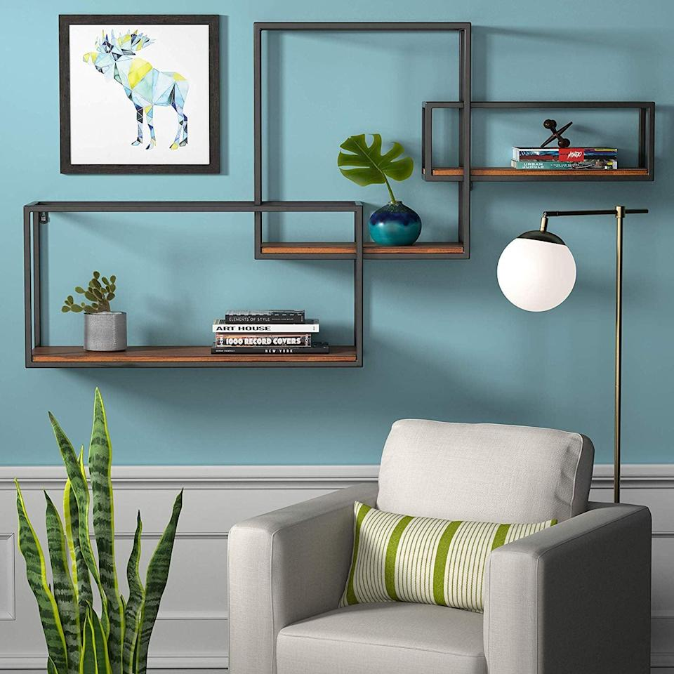 <p>You can put all your favorite decorative pieces on this <span>Rivet Contemporary Cubic Iron 3-Shelf Floating Unit</span> ($64).</p>