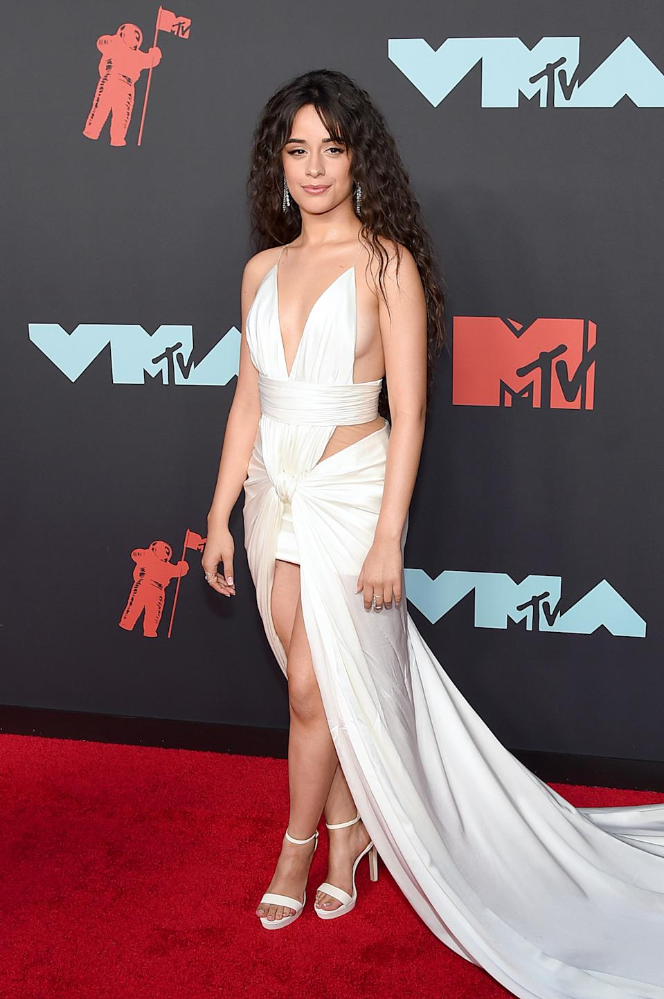 """<h1 class=""""title"""">Camila Cabello in Balmain and Amwaj and Djula jewelry</h1><cite class=""""credit"""">Photo: Getty Images</cite>"""