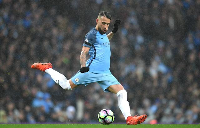 <p>Nicolas Otamendi moves to clear the ball </p>