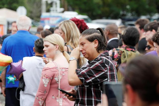<p>Guests react to the memorial outside the Pulse Nightclub on the one-year anniversary of the shooting in Orlando, Florida, June 12, 2017. (Scott Audette/Reuters) </p>