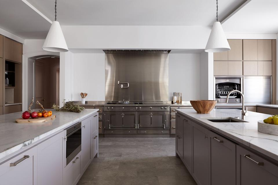 "<div class=""caption""> ""This is probably my favorite kitchen that I've ever done,"" gushes Story. A custom La Cornue range and metallic backsplash coordinate with quartzite countertops, plaster pendants by Rose Uniacke, and burnished nickel hardware by Nanz. </div>"