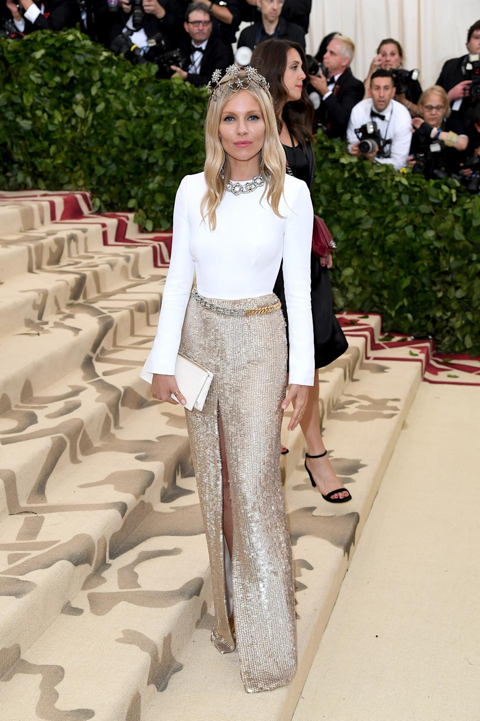 """<h1 class=""""title"""">Sienna Miller in Louis Vuitton, Fred Leighton jewelry with a Jimmy Choo bag</h1><cite class=""""credit"""">Photo: Getty Images</cite>"""