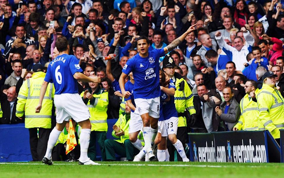 Everton's Australian midfielder Tim Cahill celebrates scoring against Liverpool during their English Premier League football match against Everton at Goodison Park in Liverpool, north-west England, on October 17, 2010