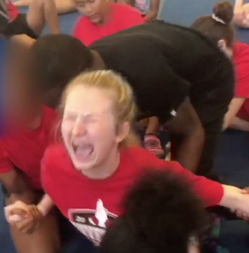 Shocking video of a 13-year-old girl being forced into splits has led to a police investigation. (CBS News)